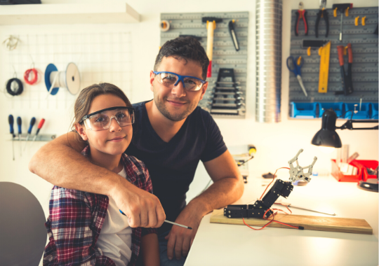 heart warming photo of father and daughter in a woodworking shop